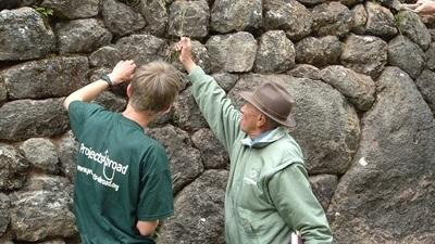 Volunteer working on restoration of murals on the Inca project in Peru