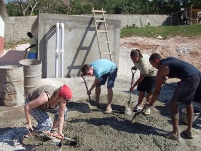 Gap Year volunteers gather cement to construct a building on the Building project in Jamaica
