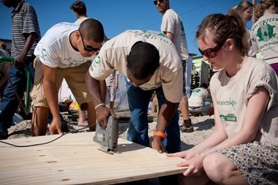 Volunteers help build a community building in South Africa