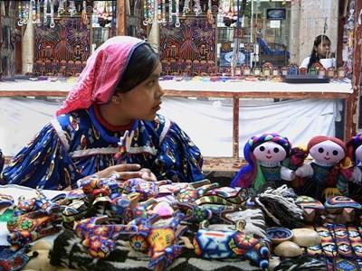 Local woman sells artisan crafts at a local market in Mexico