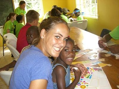 Volunteers work with children in a disaster management workshop in Jamaica