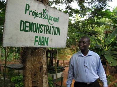 Staff member shows the volunteer demonstration farm created in Ghana with Projects Abroad