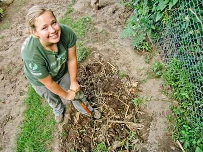 Volunteer digging a plot of lank for the Farming project in Argentina