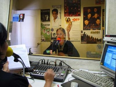 Journalism intern interviews on the air on a radio show in Bolivia