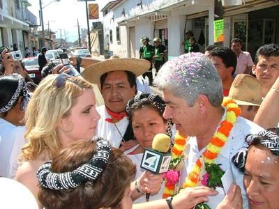 Journalism radio interview during a street festival in Mexico