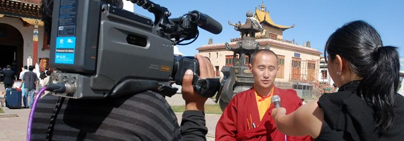Intern on the film production project films with a monk