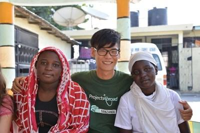Volunteer works with locals to create a project for the film production program in Tanzania