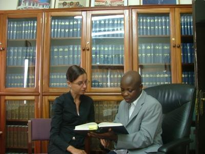 Law intern in Ghana discusses cases with staff