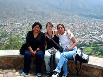 Volunteers sitting on a viewpoint overlooking the local town on a Projects Abroad placement in Bolivia