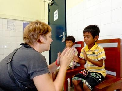 Volunteer playing games on the Occupational Therapy project in Cambodia