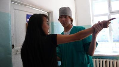 Intern on the Physical Therapy project in Mongolia does a check up on a patient