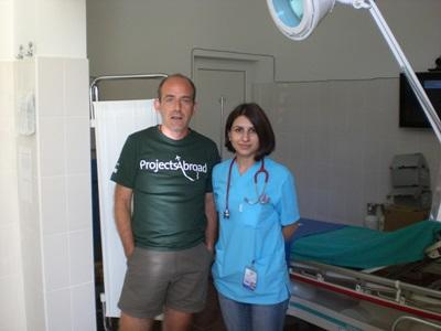 Volunteer with local staff in a clinic on the Physical Therapy project in Romania