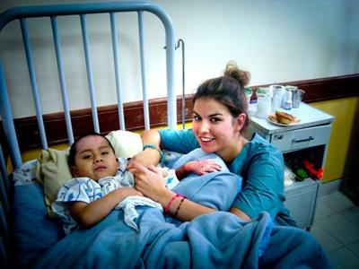 Volunteer nurse working with a child in a hospital in Bolivia
