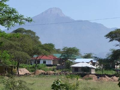 A group of buildings in a rural area in Tanzania.