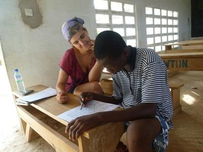 Speech therapy intern in Togo works on a worksheet with a patient in Togo
