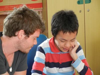 Volunteer on the Speech Therapy project works with a child in a clinic in Vietnam