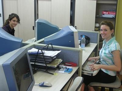 Volunteer working on the computer of an office overseas on the Business project
