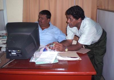 Two businessmen at work at a Business internship placement in Sri Lanka.
