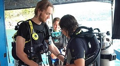 Volunteer suits up in scuba gear for the Diving & Marine Conservation project in Cambodia