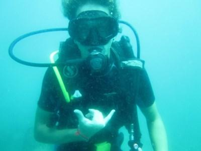 Volunteer having fun underwater during a dive on the Marine Conservation project in Cambodia