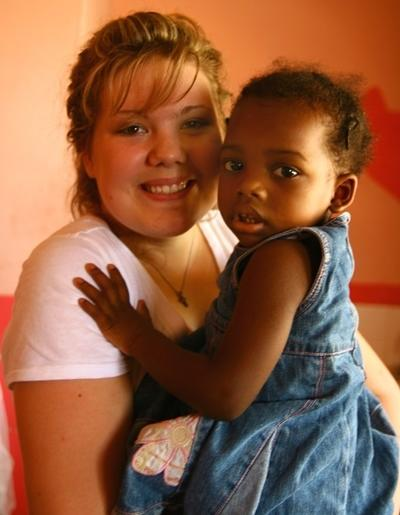 Volunteer takes part in orphanage work with young children in Jamaica on the Care project