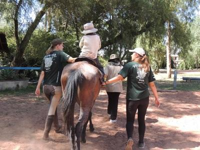 Volunteer helping special needs children on the Equine Therapy project in Bolivia