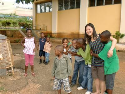 Volunteer with children on the HIV/AIDS outreach project in Jamaica