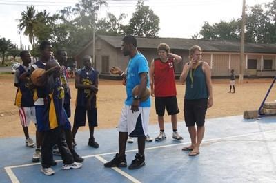 Volunteers lead a basketball practice in a school in Ghana