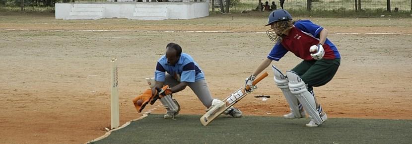 Gap Year volunteer plays cricket at a school in Togo