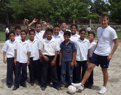 Volunteer soccer coach with the team that he coaches in Costa Rica