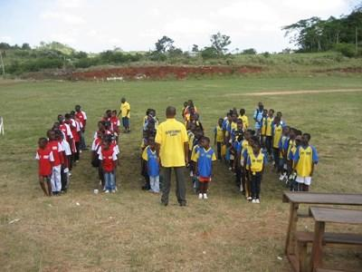 School children coached by volunteers in Jamaica, the Caribbean