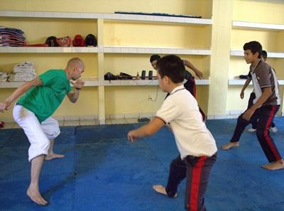 Volunteer coach children in a school club in Mexico