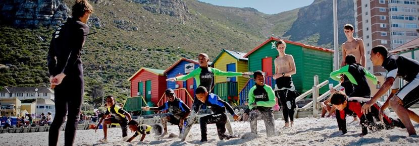 Volunteers on the beach on the surfing project in South Africa with Projects Aboard