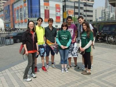 Volunteers in China practice speaking Mandarin on the street