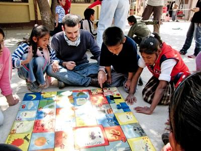 Young Bolivian students work on an activity with the help of a volunteer