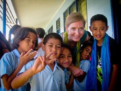 Volunteer with her students outside of a classroom in Samoa with Projects Abroad