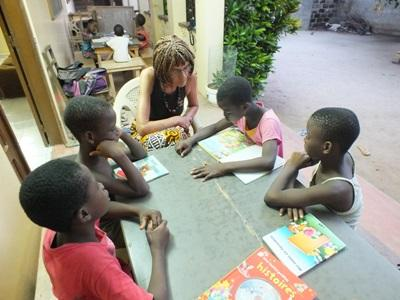 Several Togolese children study with a Teaching volunteer