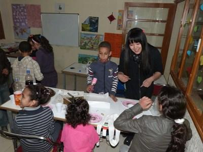 Volunteer does crafts with students in a school in Morocco on the Teaching project