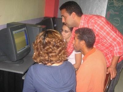 Volunteer teacher teaches computer skills to students in a school in Morocco, Northern Africa