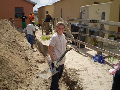 Teen volunteer helping to build a home in South Africa