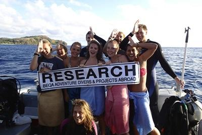 Teenage Shark Conservation volunteers pose for a picture after a dive in Fiji