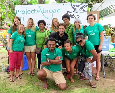 Volunteers and local staff pose for a photograph in Fiji, South Pacific