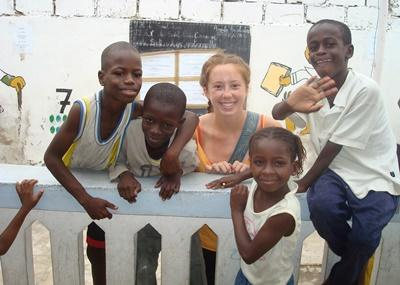 Volunteer on the Care & Community project in Senegal plays with kids outside