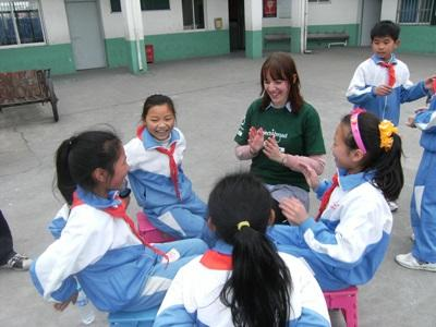 High School Special volunteer plays games with school girls on an Animal Care project in China