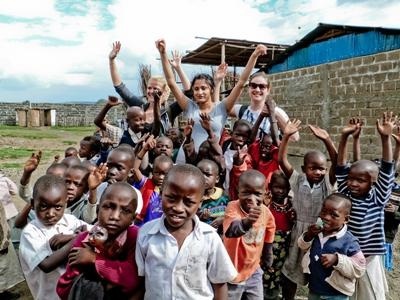 Volunteer with a class of young children at a care center in Ghana on the Care & Community project