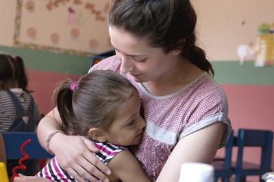 A Costa Rican child hugs a Care volunteer