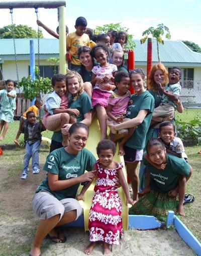 Volunteer at a playground with children on a project in Nadi, Fiji