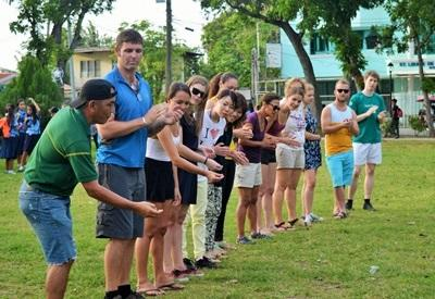 Volunteers in a group playing a game in the Philippines
