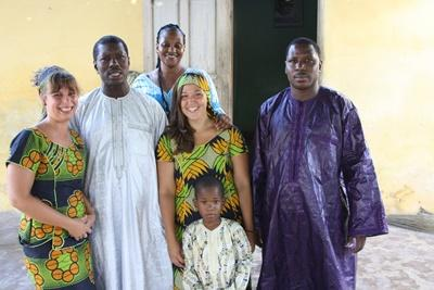 Projects Abroad volunteer with their local host family in Senegal, Africa